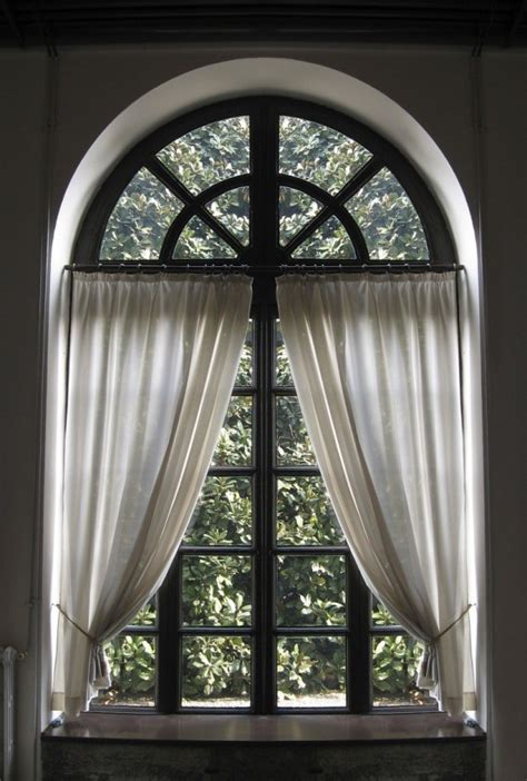 how to hang curtains on arched window making a curtain for an arched window thriftyfun