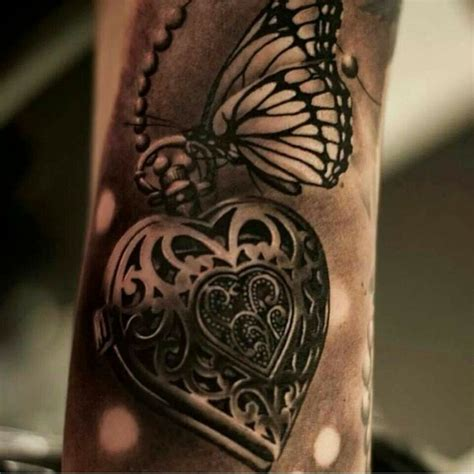 tattoo butterfly with heart locket and butterfly arm tattoo tattoomagz