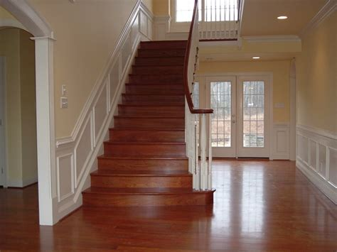 brazilian cherry stairs with wainscoting