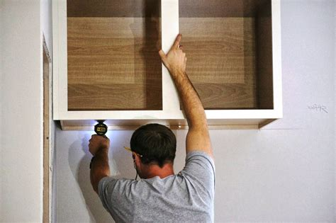 how do you hang kitchen wall cabinets how to hang a cabinet manicinthecity