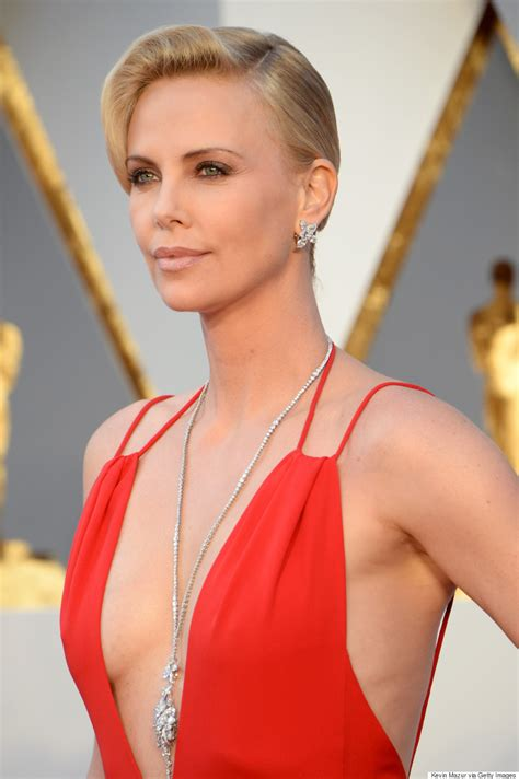 2016 hot charlize theron charlize theron s oscars 2016 gown is red hot