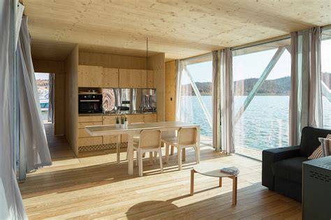 floatwing modular floating house by portugal s friday friday sa s modular houseboat can be expanded to 18 meters