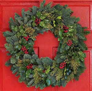 holiday wreath deck the walls and doors with these 23 holiday wreaths