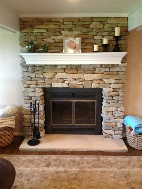 the new refaced fireplace with new fireplace doors and