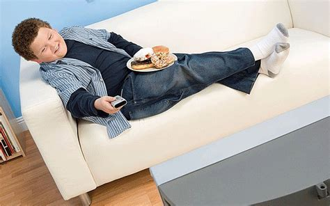 fat kid on couch children spend more time watching tv than at school