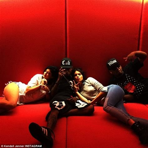 justin bieber couch kendall and kylie jenner lounge on a couch on either side
