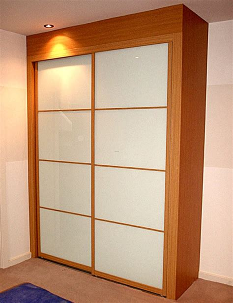 fitted bedroom furniture with sliding wardrobe doors by