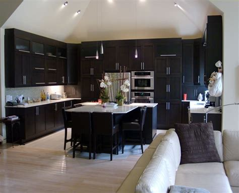 dark kitchen cabinets with dark hardwood floors have dark furniture in our living room dining room