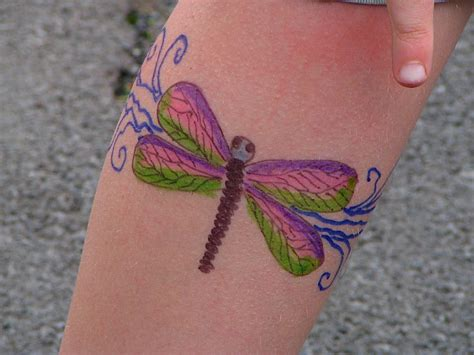 tattoo dragonfly black think dragonfly on foot