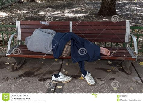 homeless man on bench sleeping homeless man on the bench editorial stock photo