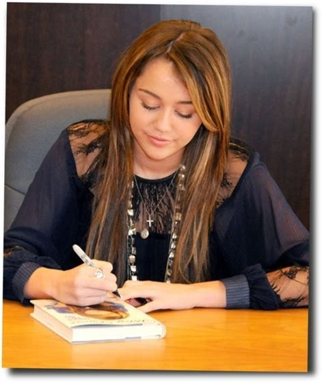 biography miley cyrus miley autographing her biography miley cyrus photo