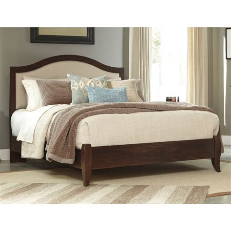 pictures of beds ashley furniture corraya queen panel bed in medium brown
