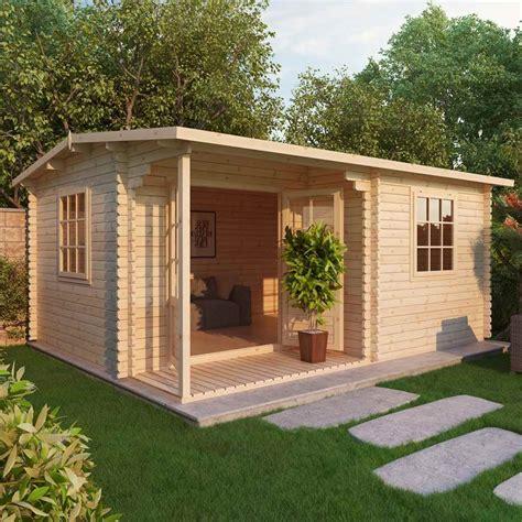Chestnut Log Cabin by Shedswarehouse Oxford Log Cabins Installed 4m X 3m