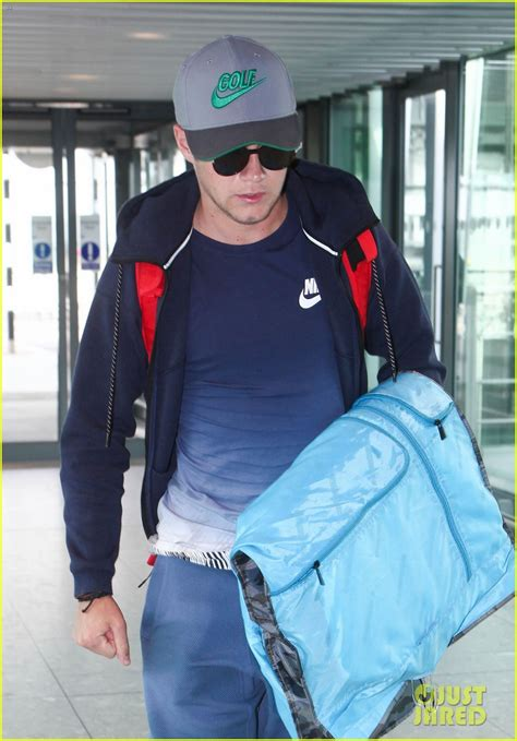 heres the irish model niall horan had a cheeky kiss with its niall horan lands in dublin ahead of the irish open 2016