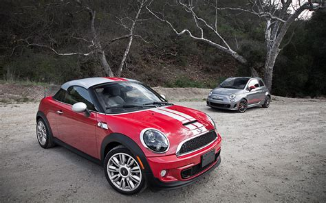 2012 fiat 500 abarth vs 2012 mini cooper s coupe parked