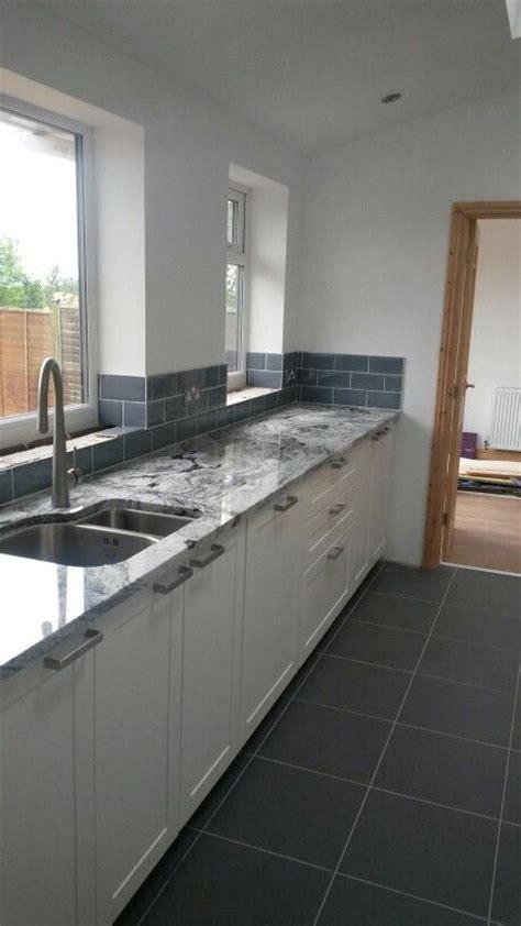 metro cabinets granite creations viscount white granite with blue ice metro tiles kitchen