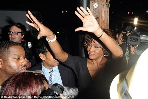 Whitney houston emerges from a nightclub looking worse for wear