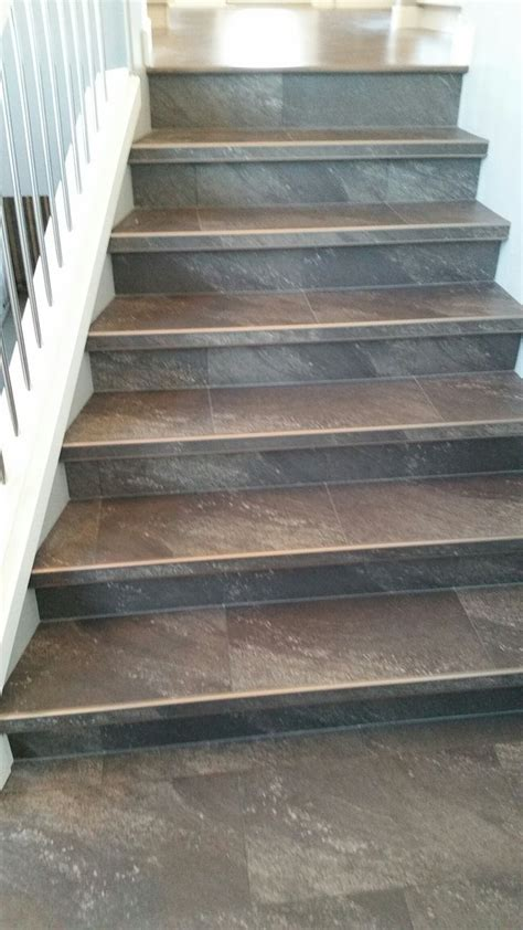 Luxury vinyl tile installed with custom insert stair