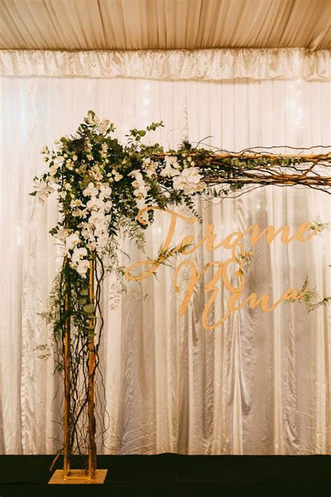 Wedding Arch Name by Wedding Arch With Florals And Laser Cut Sign With The