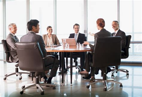The Business Of Conferences business meeting at table in conference room