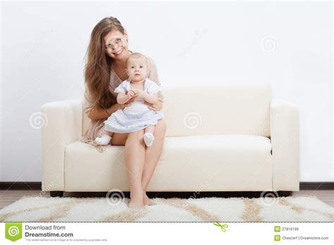 mom on sofa mother and baby on sofa royalty free stock images image