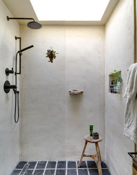 bathroom stall in spanish stone cold fox concrete shower indoor outdoor living