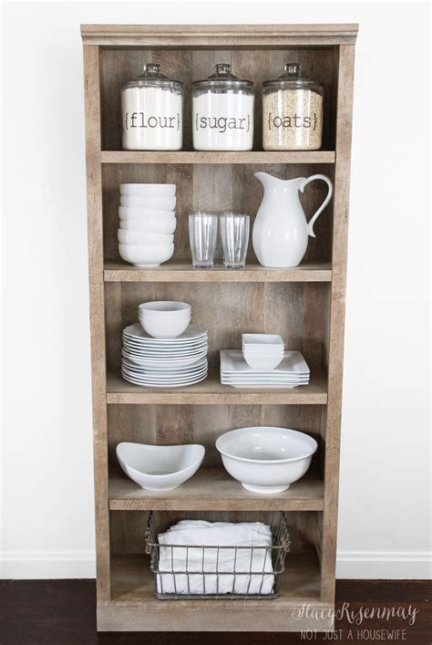 how to a pantry out of a bookcase use a bookshelf as a pantry or kitchen hutch bhg s best