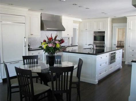 Black Floors White Cabinets by Floors White Cabinets And Black Counters It