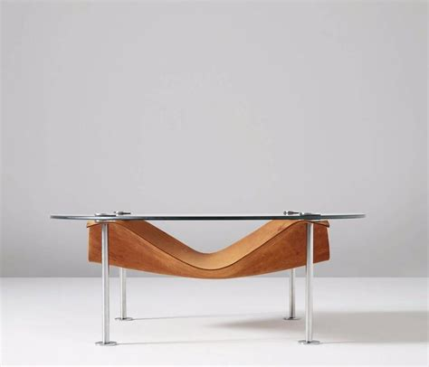 coffee table in glass and cognac leather for sale at