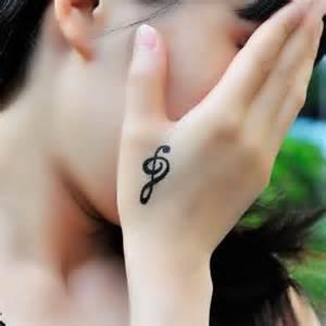 musical note staff female wrist transfer tattoo stave