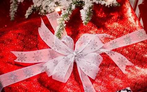 gift under the snowy christmas tree wallpaper holiday