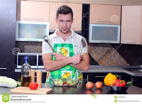 Home And Cook by Cooking Stock Photo Image Of Looking Satisfied Kitchen