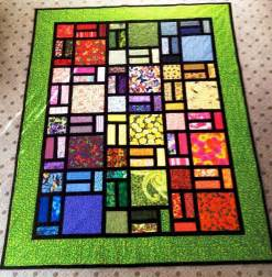easy stained glass quilt in green by pam yeomans craftsy