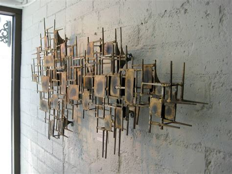 a mid century modern brass wall sculpture at 1stdibs