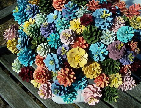 how to make pine cone flowers flower power pinterest pine cone flowers painted pine cones on 12 inch wood stems