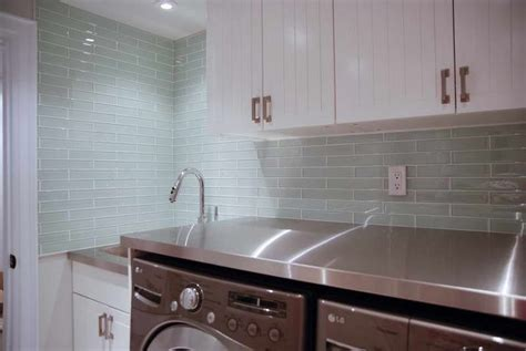 white cabinets next to quot clear quot glass tile shows hint of