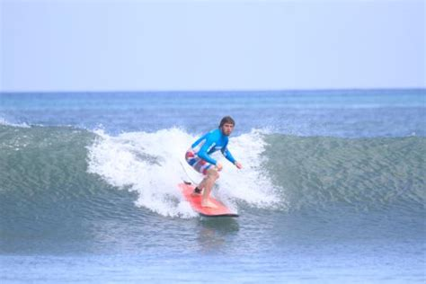 reviewing standing   kuta beach picture  pro surf