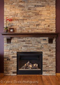 fireplace mantel with corbels with custom crown made of knotty alder vanderbelt stone