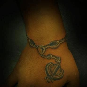 khanda tattoo designs khanda with chain on wrist tatoos