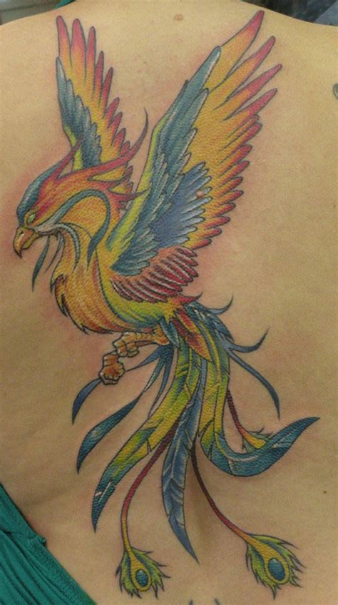 a colorful rainbow phoenix tattoo the combination of