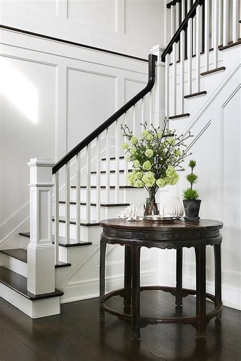 foyer staircase chic foyer opens to a staircase fitted with white spindles