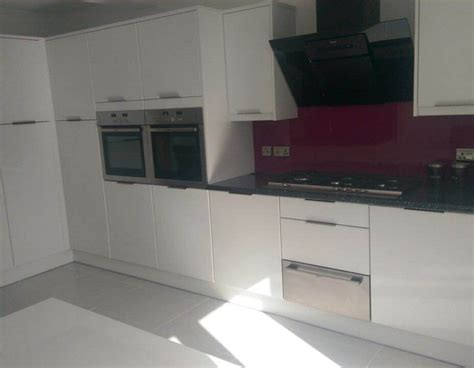 Black Gloss Kitchen With White Worktops by Kitchens Fitted Kitchens Abergavenny Sigma 3