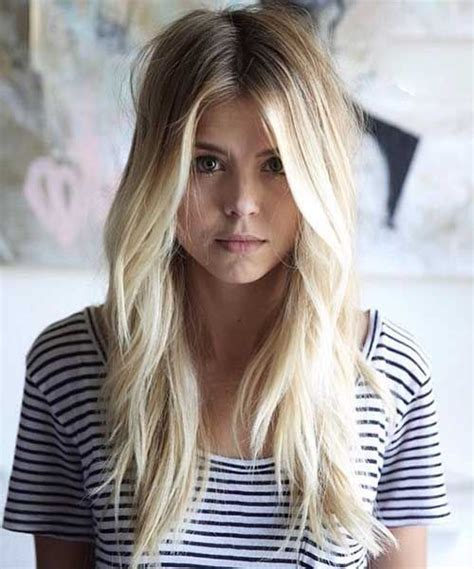 Pretty white blonde long hair with lots of front facing layers long straight layered