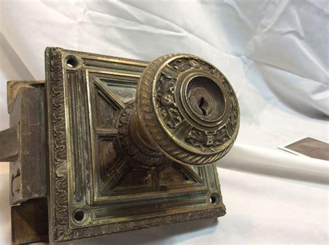antique brass door knob plate mechanism set unknown