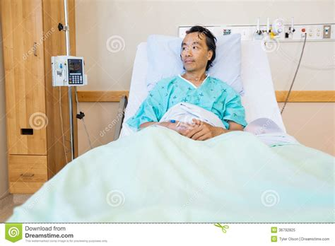 Reclining On A Bed by Patient Reclining On Bed While Looking Away In Royalty Free Stock Photo Image 36792825