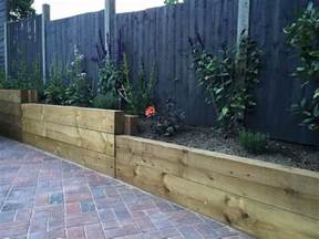 Retaining Sleeper Wall by Finished Retaining Sleeper Wall Steps Block Paving