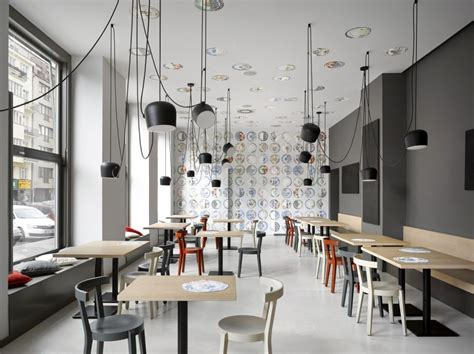 Ceiling Lights Kitchen Ideas by Cafe In Prague Proves Minimalist Interiors Can Be Playful
