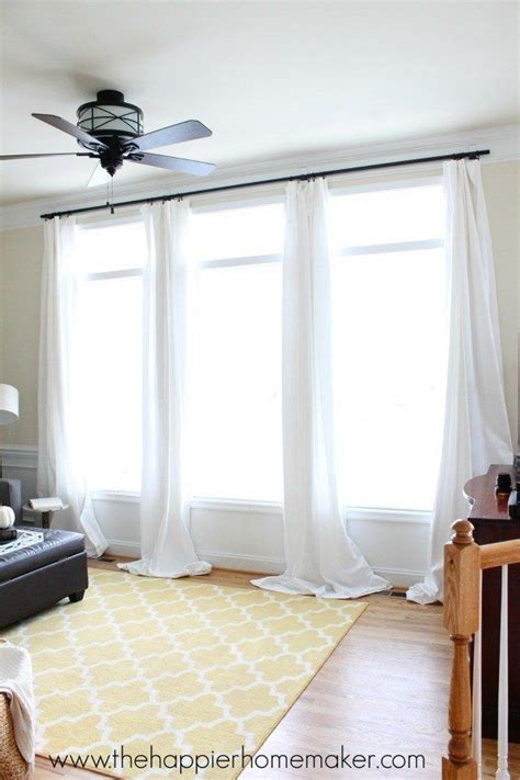 using command strips to hang curtains add some shower curtain rings and rods to the side of your