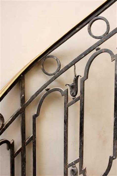 cast iron banister with brass rail stairs and banisters