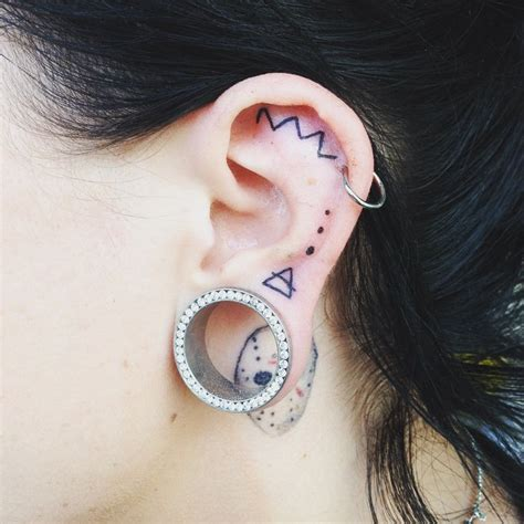 love tattoo on ear famous person 55 excellent mini ear tattoo designs meanings powerful